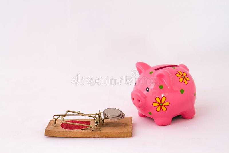 Retirement savings concept with piggy bank and coins. A piggy bank and some coins retirement savings concept image with copy space in landscape format on a white royalty free stock photos