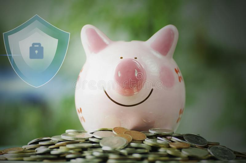 Piggy bank on stacked on money coin with protection and save. Concept stock images