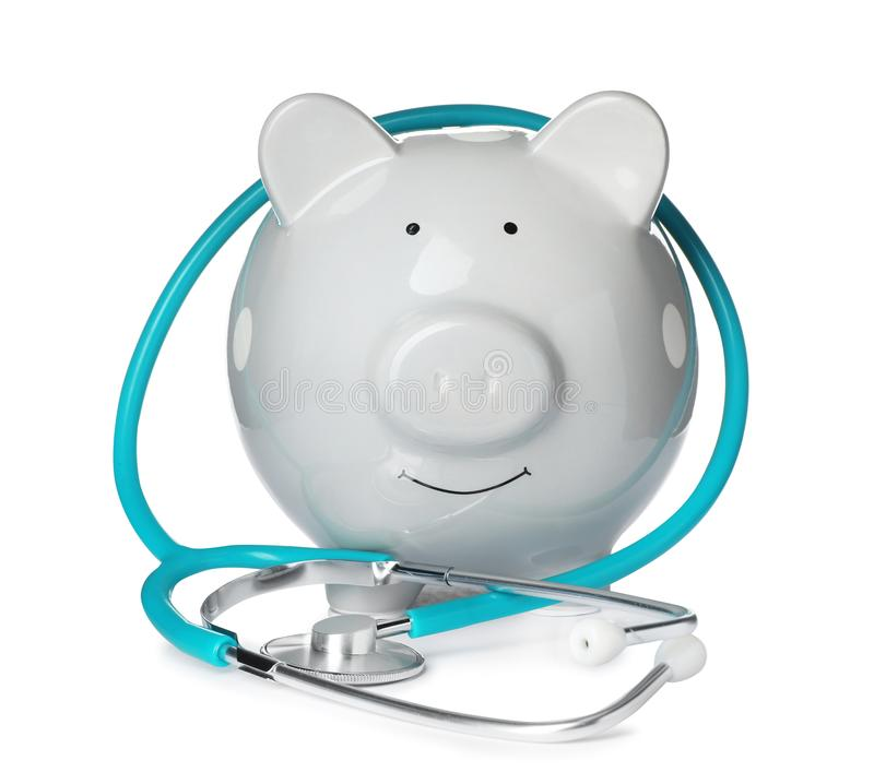 Piggy bank with stethoscope isolated. On white stock photo