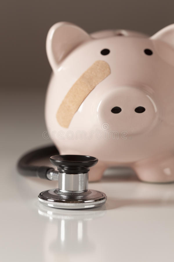 Download Piggy Bank And Stethoscope With Selective Focus Stock Photo - Image: 21471280