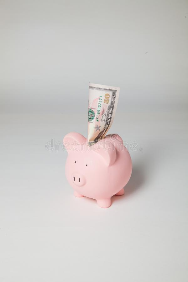 Piggy Bank with $50 sticking out royalty free stock photos