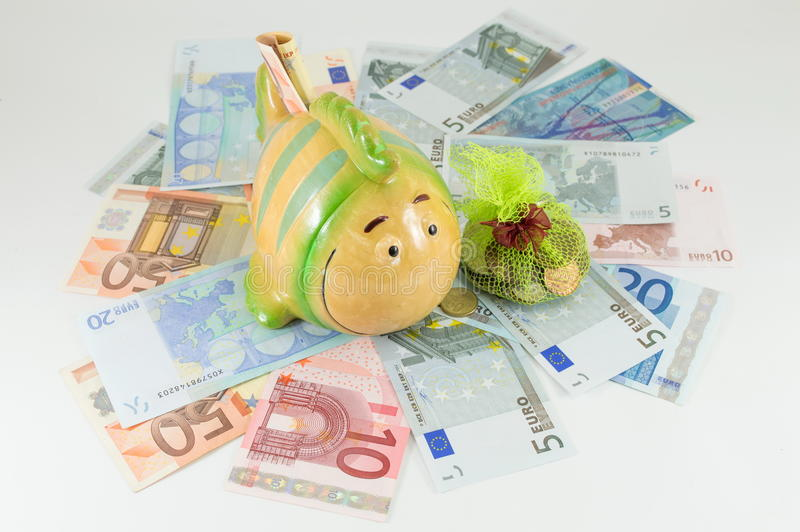 Piggy bank on top euro bills royalty free stock images