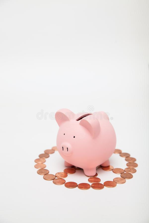 Piggy Bank on top of a peace sign stock images