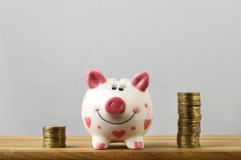 Piggy bank and towers coins. Copy space. stock photo