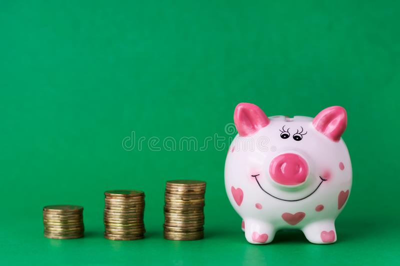 Piggy bank and towers coins. Copy space. royalty free stock photo