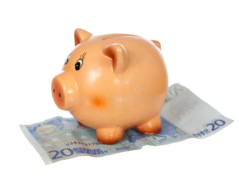 Piggy bank on twenty euro note. Isolated on white royalty free stock photography