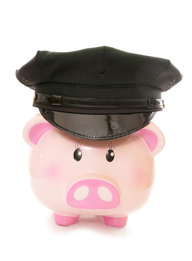 Piggy bank wearing american police cap. Cutout stock images