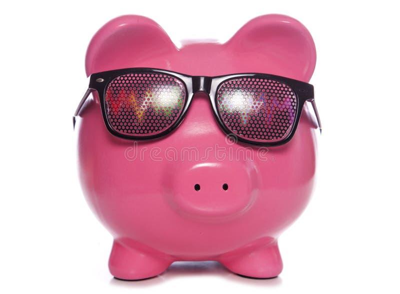Piggy bank wearing Raving party glasses. Studio cutout stock photos