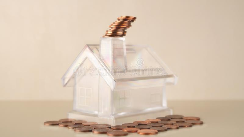 Piggy bank white transparent house with chimney, coins stack smoke, management business financial and investment, flat coins botto royalty free stock photo