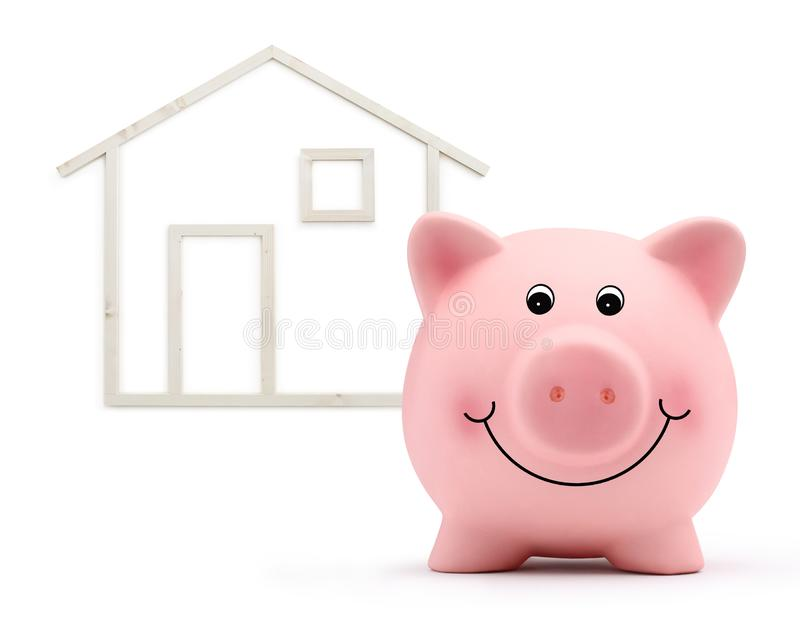 Piggy bank with wood house shape isolated on white background, real estate and savings purchase. Concept stock images