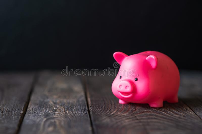 Piggy Bank on wooden background stock image