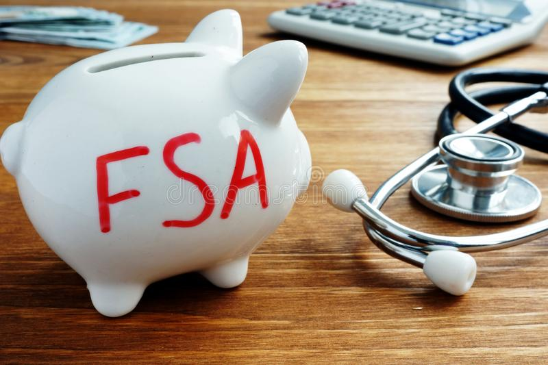 Piggy bank with letters Flexible Spending Account FSA. Piggy bank with words Flexible Spending Account FSA stock image