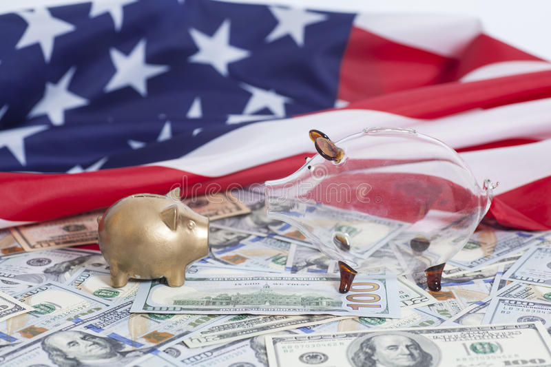 Piggy Banks on Dollars with American Flag royalty free stock photo