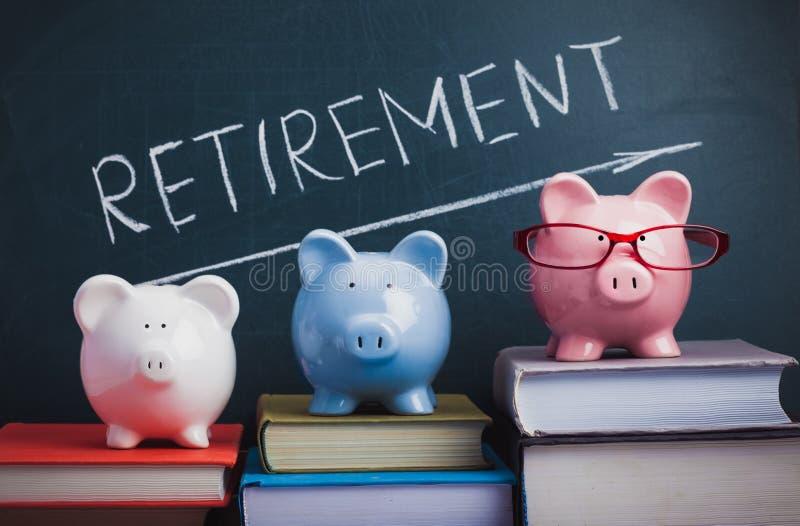 Piggy Banks and Retirement Word on Chalkboard. Retirement piggy bank retirement plan eyeglasses chalk board chalkboard saving money royalty free stock photo