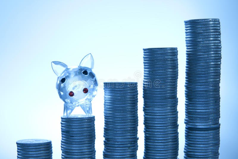Download Piggy With Coins On Blue Background Stock Photo - Image: 16892622