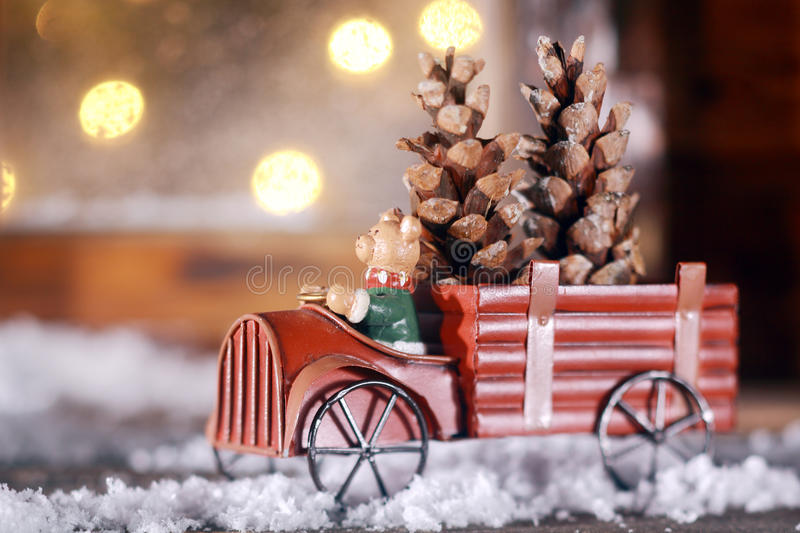 Piggy making a delivery of Xmas cones stock image
