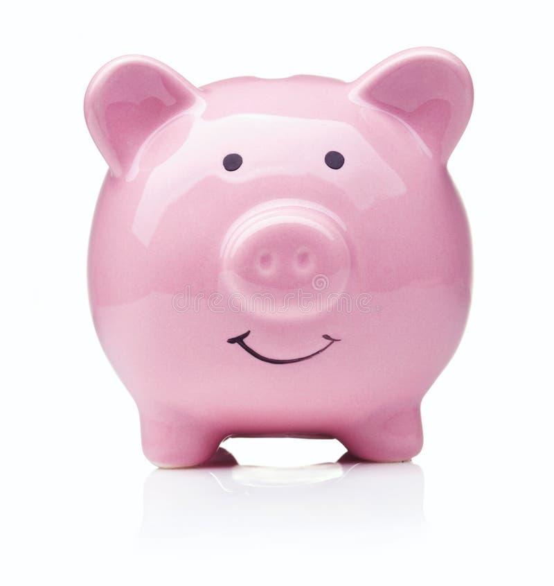 Piggy Querneigung getrennt lizenzfreie stockbilder