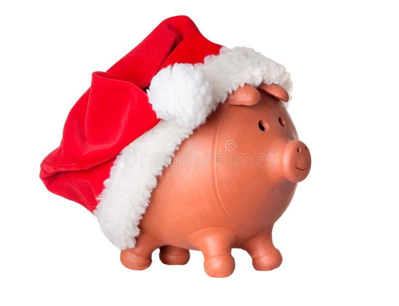 Piggy Querneigung mit Weihnachtsmann-Hut lizenzfreie stockfotos