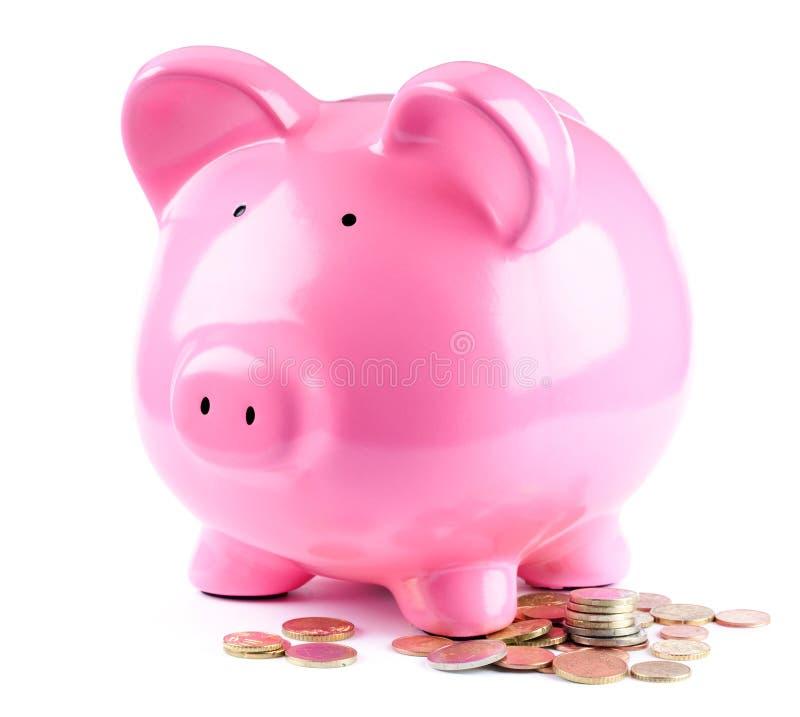 Piggy Querneigung und Münzen stockbilder