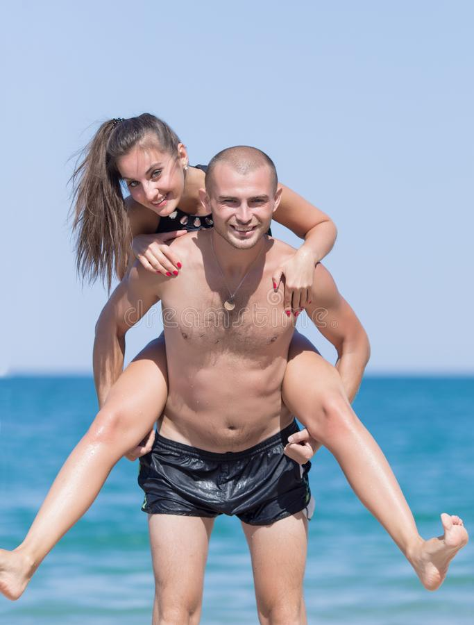 Attractive couple playing at the sea royalty free stock photo
