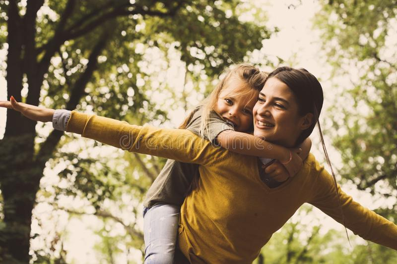 Piggyback ride. Happy single mother. royalty free stock photography