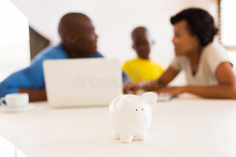 Piggybank close up. African family doing some financial planning with piggybank close up royalty free stock image
