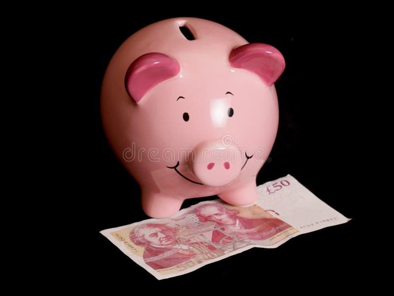 Piggybank com nota de cinqüênta libras imagens de stock