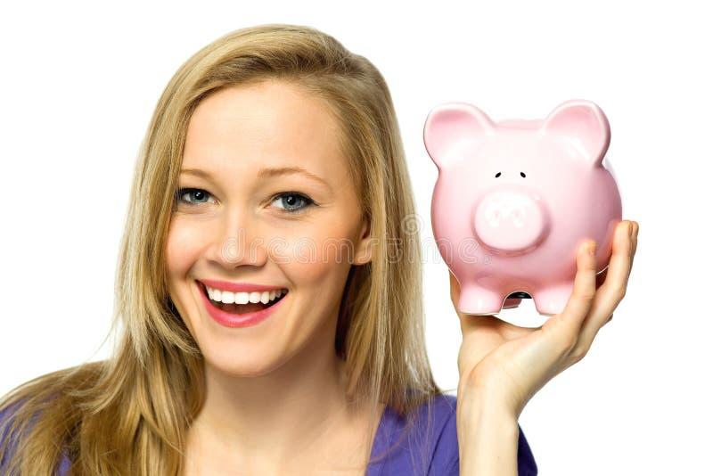 Piggybank de fixation de femme images libres de droits