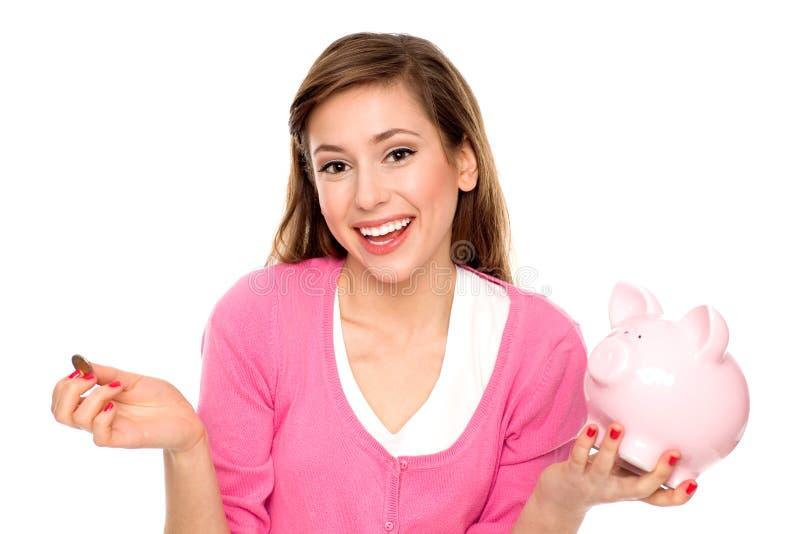 Piggybank de fixation de jeune femme photos stock