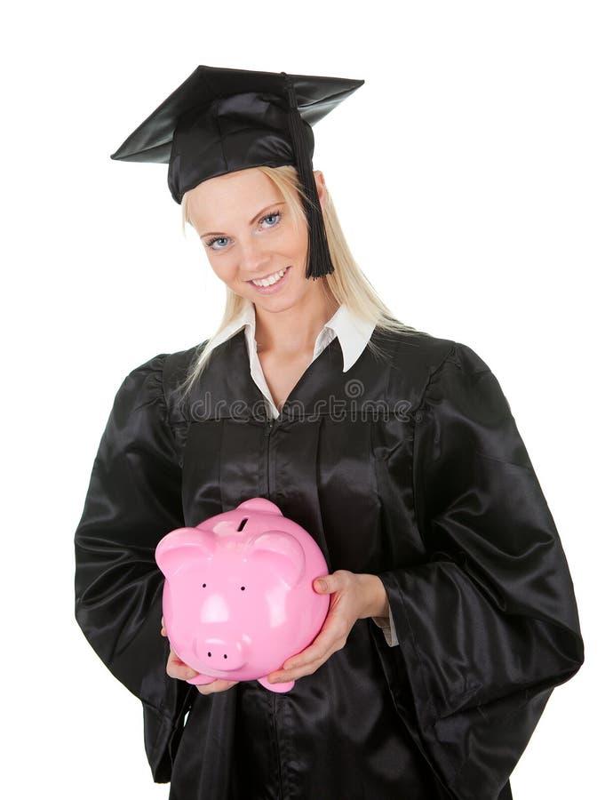 Piggybank fêmea da terra arrendada da estudante de terceiro ciclo foto de stock royalty free