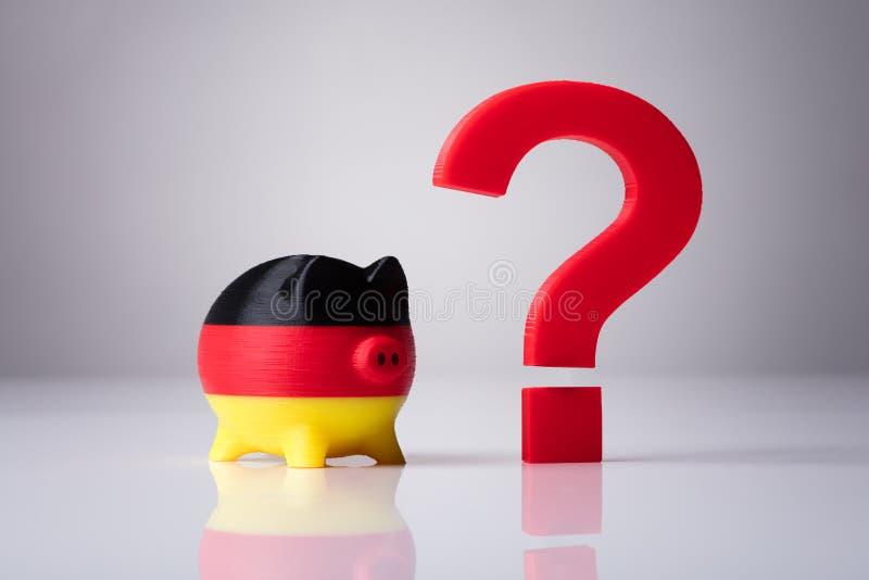 Piggybank Malował Z niemiec flagą I znak zapytania znakiem zdjęcia royalty free