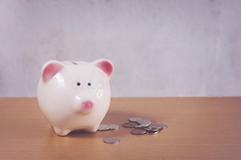 Piggybank and money tower stock photography