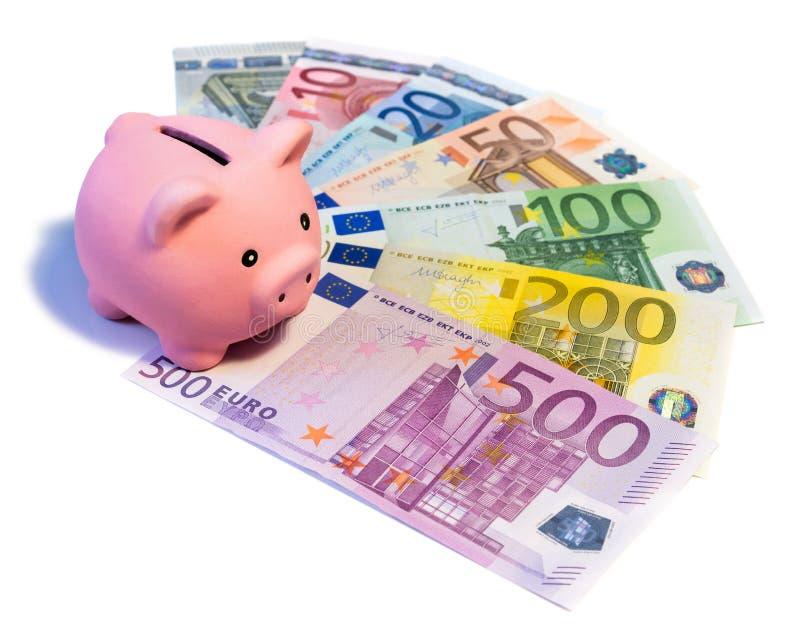 Piggybank op euro bankbiljetten stock afbeeldingen