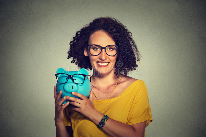 Piggybank and woman wearing glasses royalty free stock photo