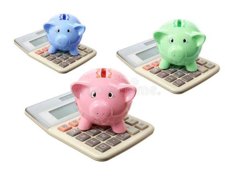 Piggybanks i kalkulatorzy zdjęcie royalty free