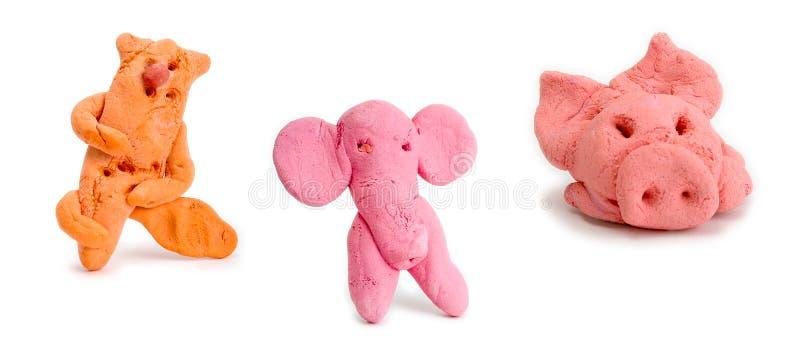 Piglet, elephant and cat. Homemade toys - figurine of piglet, elephant and cat royalty free stock images