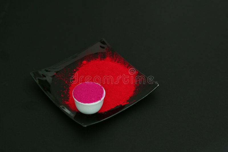 Pigment. Red pigment in a cup of a painter royalty free stock photography