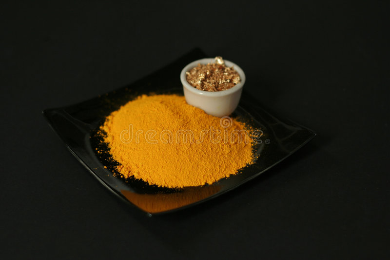 Pigment. Yellow pigment in studio of a painter royalty free stock photo