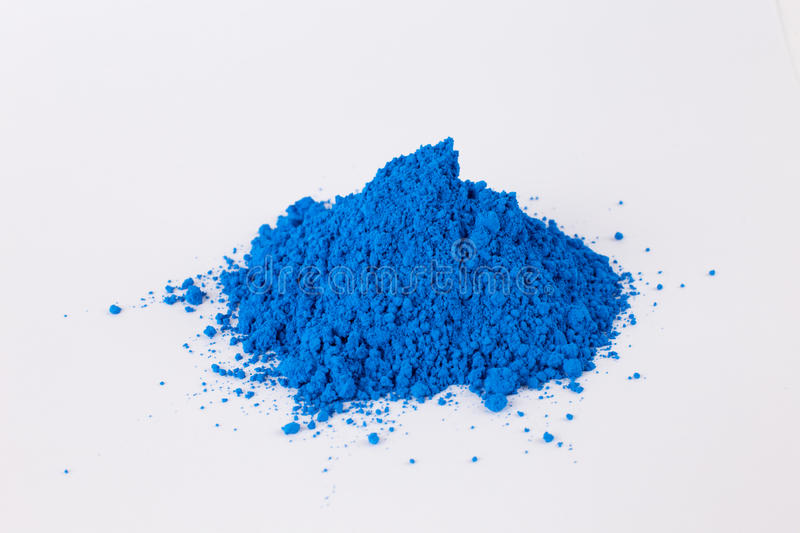 Pigment on a white background. Blue pigment in a bottle stock photo