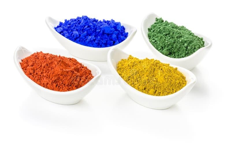 Pigmentos vibrantes da cor em umas bacias fotografia de stock
