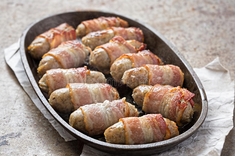 Pigs in blankets. On steel platter royalty free stock images