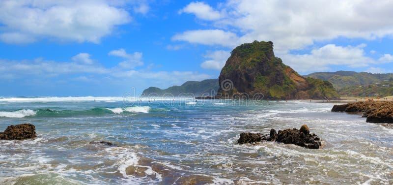 Piha Beach and Lion Rock panorama, New Zealand. Piha Beach and Lion Rock panoramic view, New Zealand royalty free stock photography