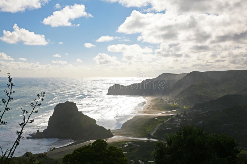 Piha Beach, New Zealand. Lion rock and piha beach from above, near Auckland in the Waitakere Ranges, New Zealand stock photography