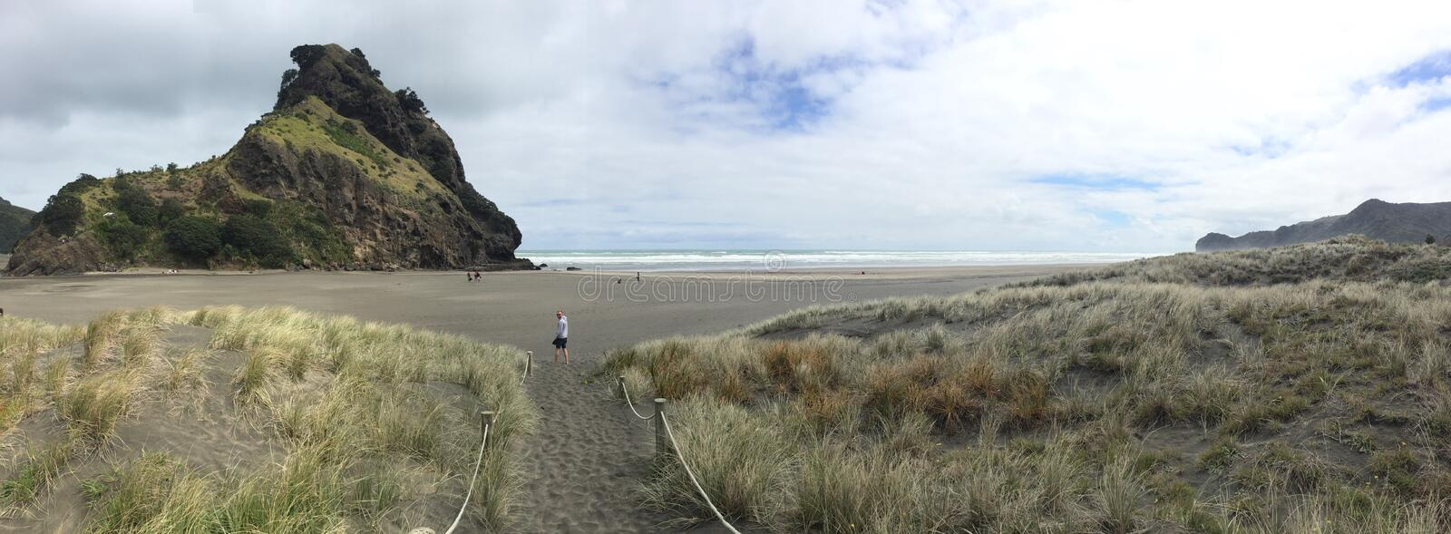 Piha Beach Pano. Spring afternoon on Piha black sand beach royalty free stock photography
