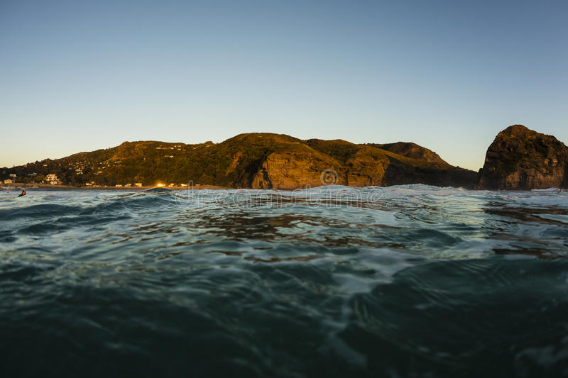 Piha Beach. Sunset out in the water at Piha Beach on Auckland's Westcoast, New Zealand royalty free stock photo