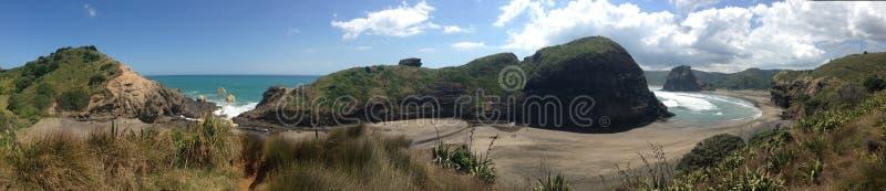 Piha beach. With the Taitomo Island and lion rock in Piha New Zealand stock photo