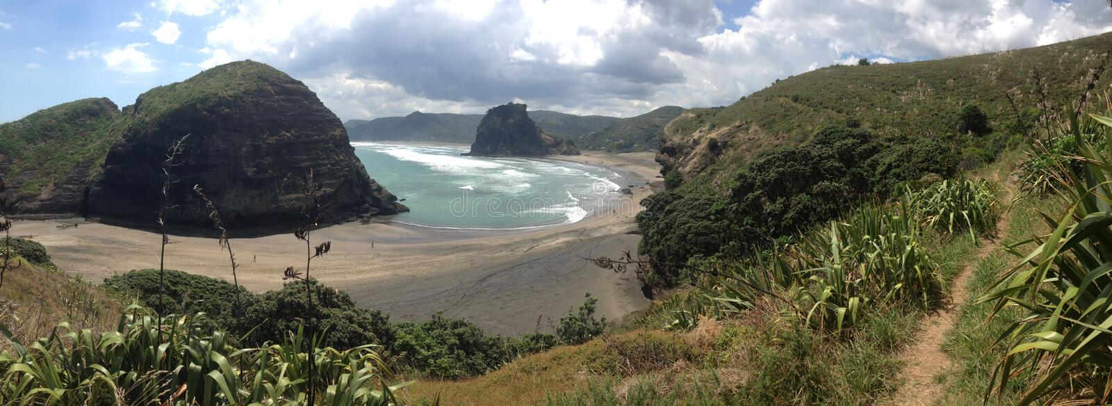 Piha beach. With the Taitomo Island and lion rock in Piha New Zealand royalty free stock images