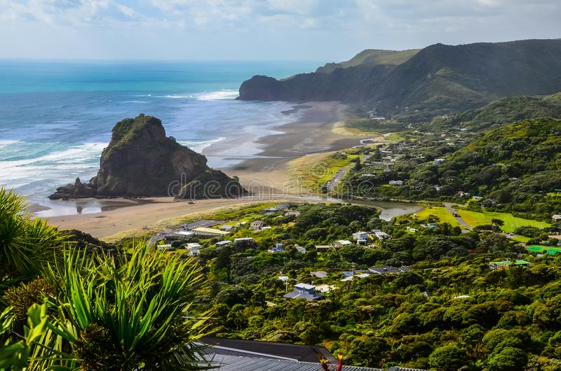 Piha Beach view from lookout with blue sky with white clouds above, Northland, North Island, New Zealand royalty free stock images