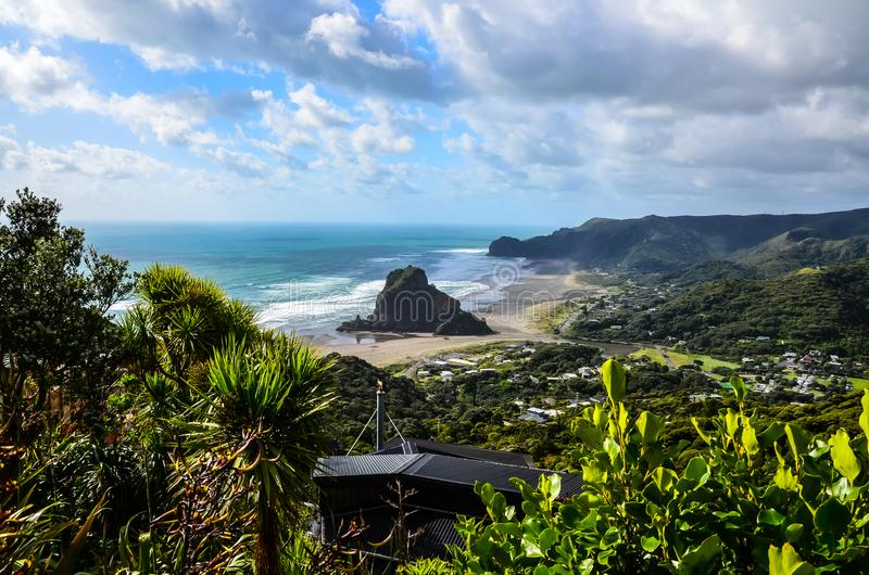 Piha Beach view from lookout with blue sky with white clouds above, Northland, North Island, New Zealand. Piha Beach view from lookout view blue sky with white stock images