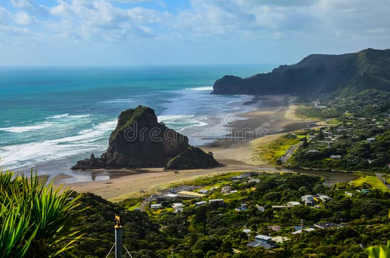 Piha Beach view from lookout with blue sky with white clouds above, Northland, North Island, New Zealand royalty free stock image
